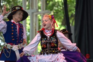 Two children, dressed in traditional attire, dance at Milwaukee's Polish Fest in 2012.