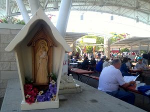 Catholicism plays an important role in the celebration of Polish Fest. Small religious shrines like this one can be found throughout the grounds during the festival.