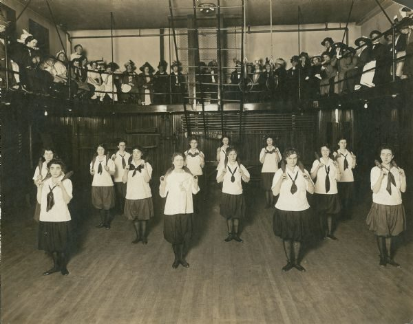 A group of young women are gathered at the Milwaukee YMCA for an exercise class in this undated photograph.