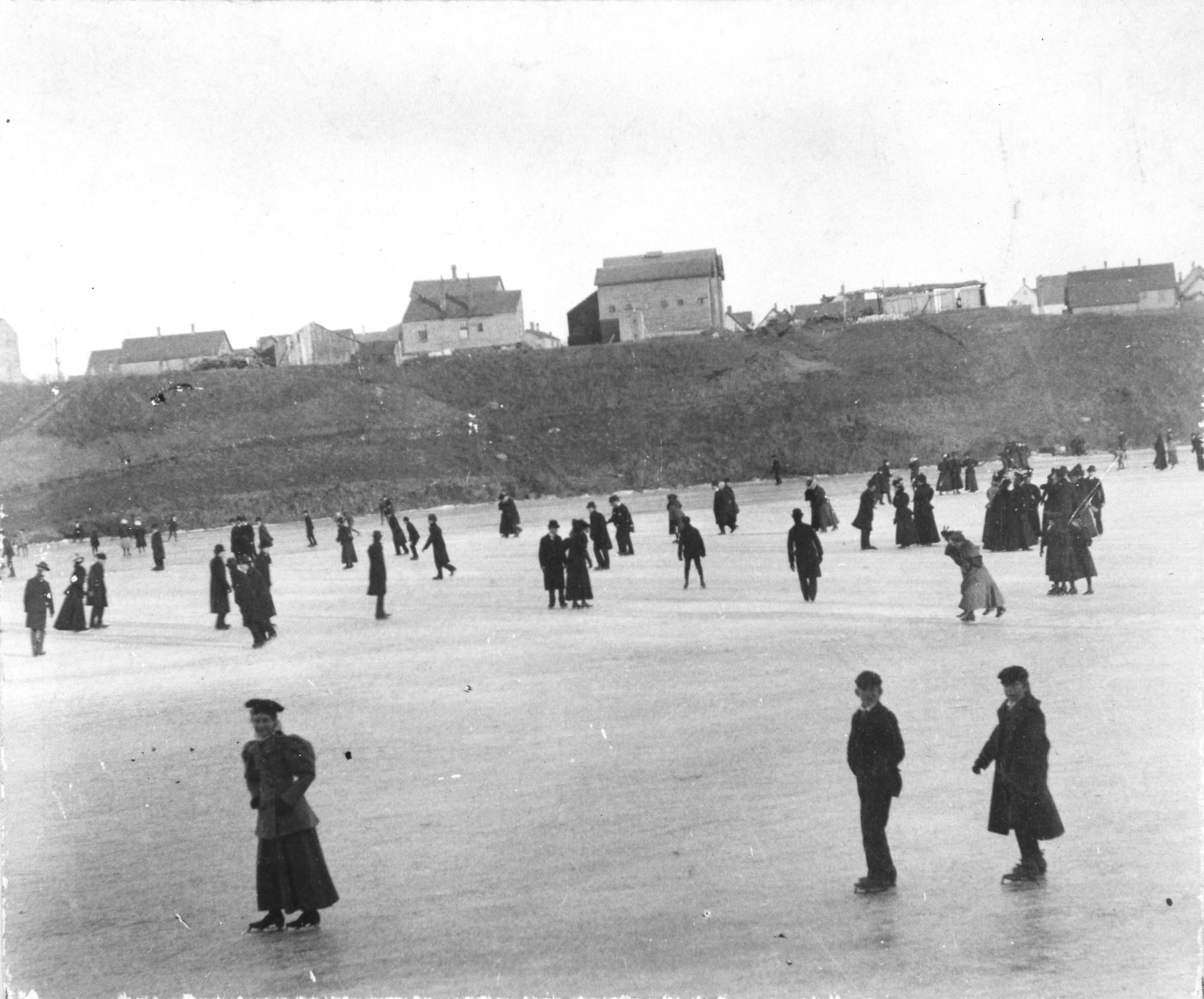 Pictured here in January of 1897, city residents ice skate on the Milwaukee River near Wright Street.