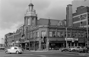 The Tower Theater was located on the southwest corner of 27th and Wells. The building still stands, but the tower was removed shortly after this photograph was taken in the 1970s.