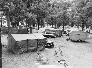 Cars, tents, and campers are gathered at Big Foot Beach State Park in this photograph from August, 1959.