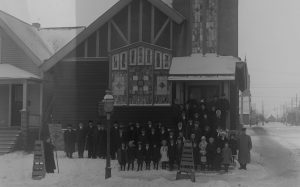 In this 1916 photograph, a group of people are gathered in front of the St. Peter's Polish Methodist Church on South 12th Street. The building still stands today.