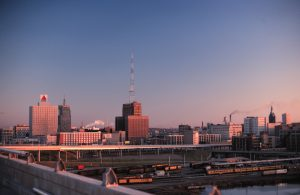 The sun rises over Milwaukee in this northeast view from the high rise bridge of I-94 while it was under construction in 1968.