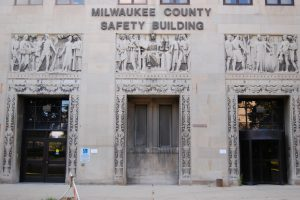 "A detailed view of the doors to the Milwaukee County Safety Building highlights that ""Safety,"" ""Justice,"" and ""Equality"" are inscribed above each of them."