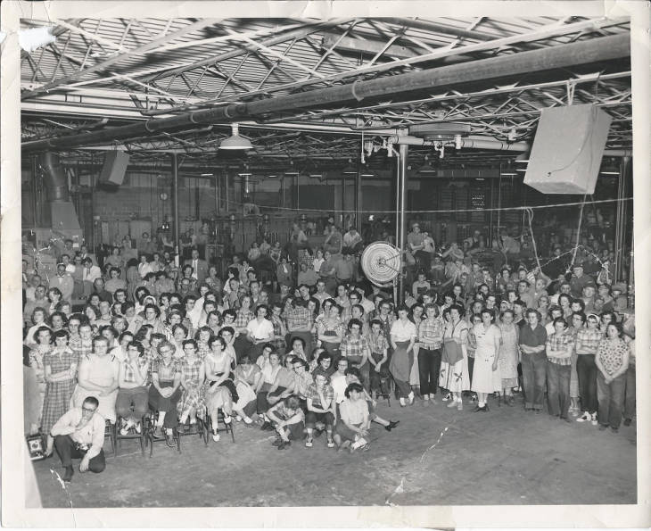 Regal Ware employees are gathered together for a group photograph inside the Kewaskum factory.