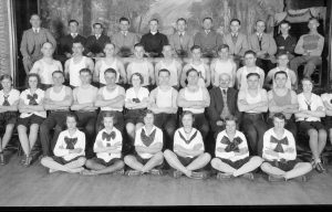 Photograph of a group of young men and women part of a Sokols gymnastics group, taken in 1931.