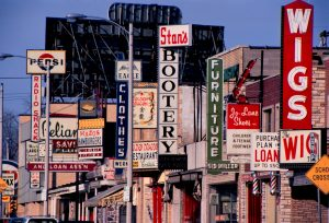 A colorful array of signs line S. 27th Street near Oklahoma Avenue in 1969.