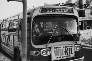 A woman sits on a Milwaukee County bus in 1979.
