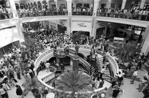 Constructed in response to suburban shopping mall development, Grand Avenue Mall opened in 1982. Pictured here are crowds gathered for opening day festivities.