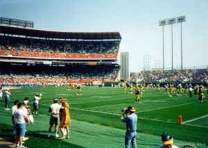 The Green Bay Packers run through pre-game drills at County Stadium for an early season game in the 1990s.