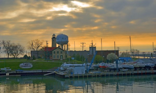 Pictured here in 2012, the Port of Kenosha sits along Lake Michigan. Its historic light station is seen in the middle ground of the photograph.