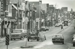 Taken in the early 1980s, this photograph features a busy North Avenue lined with both businesses and street traffic.