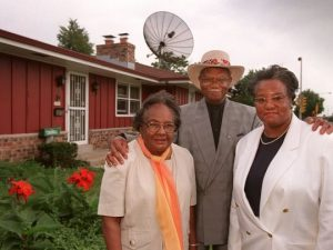 Vernadine, Beechie, and their daughter Cassie Brooks stand outside their Halyard Park home in 1997. The Brooks were the first homeowners in the Halyard Park subdivision.