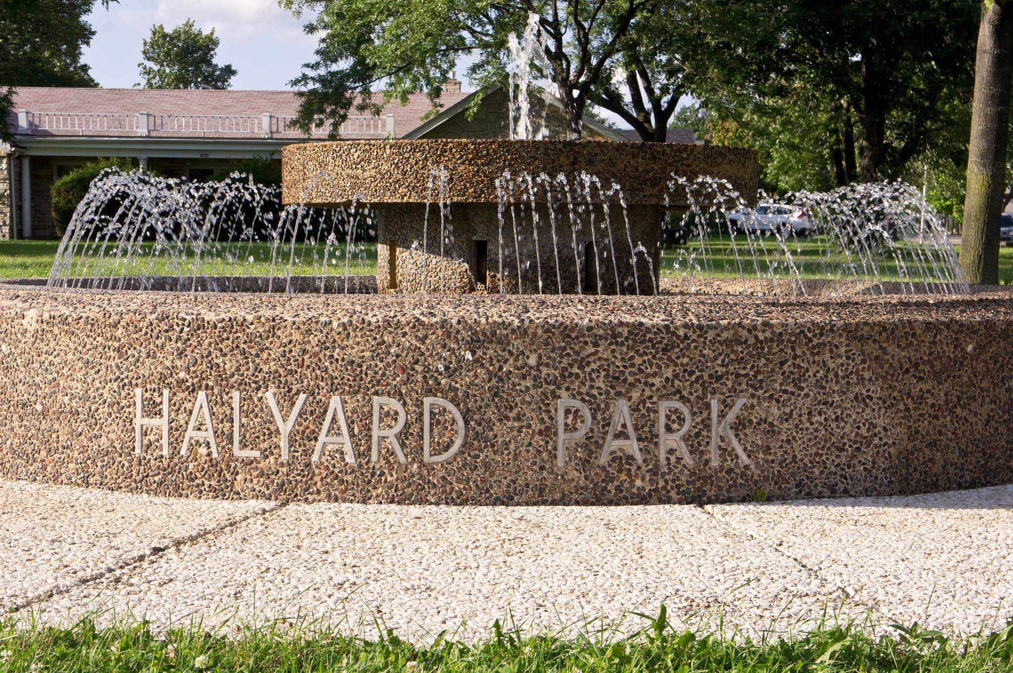 "A water fountain marks the entrance to Halyard Park and welcomes visitors to this ""suburb within a city."""