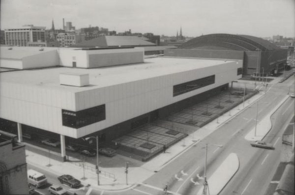 The MECCA, pictured here in the foreground, opened in 1974 and served as Milwaukee's main convention center until it was replaced in 1998. The arena to the right of the convention center is still in use and currently known as the UW-Milwaukee Panther Arena.