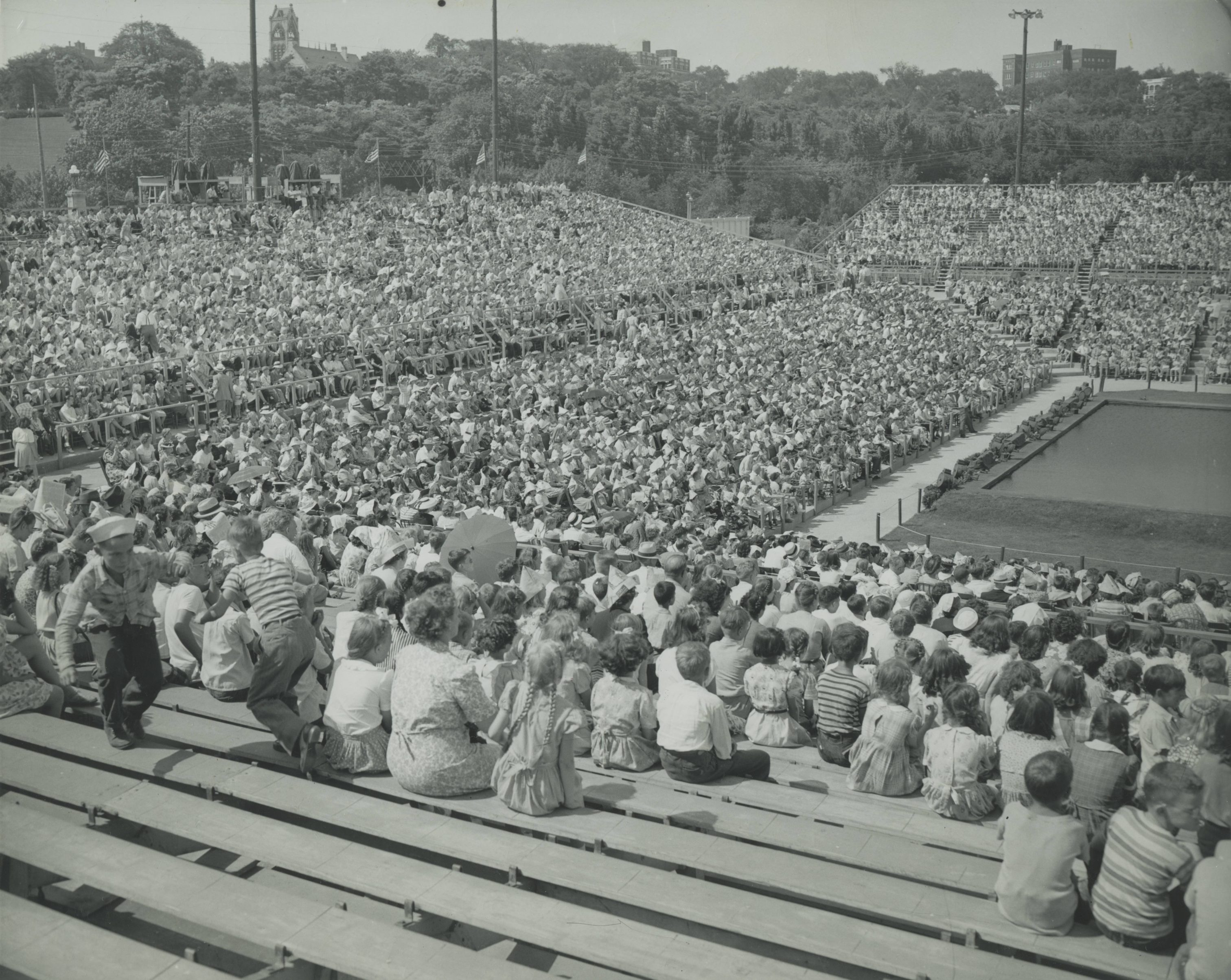 A large crowd of people fills bleachers to celebrate Milwaukee's 100th birthday. Centurama activities lasted an entire month.