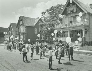 Residents of 14th Street release balloons as part of a neighborhood festival held to celebrate the beginning of a mural painted near 14th Street and North Avenue in 1982.
