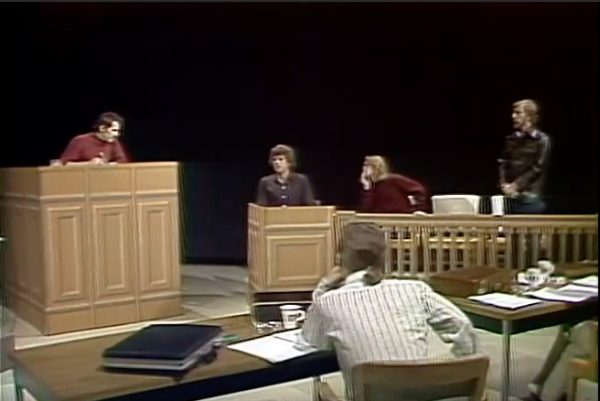 "Willem Dafoe, in the red sweater third from the left, and other members of Theater X perform in a 1975 production called ""Civil Commitment Hearings."""