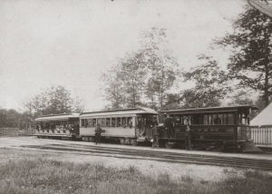 Passenger climb aboard the Milwaukee and Whitefish Bay Dummy Line at the end of the nineteenth century.