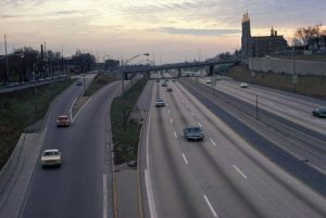 This elevated view looks south along I-94 from Greenfield Avenue in 1974. St. Stanislaus Church can be seen on the right.