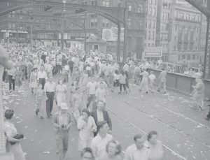 On August 15, 1945, Milwaukee celebrated Victory over Japan Day, which occurred on August 14. Here a crowd parades down Wisconsin Avenue.
