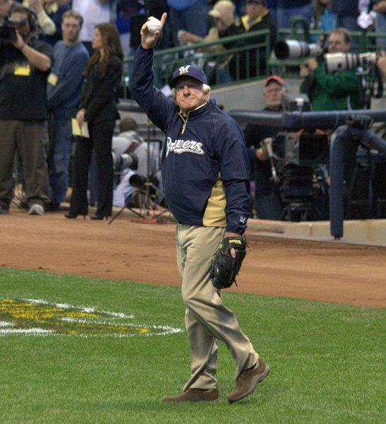 Bob Uecker acknowledges the crowd at Miller Park before throwing out the first pitch to start the NL Divisional Series between the Milwaukee Brewers and the Arizona Diamondbacks in 2011.