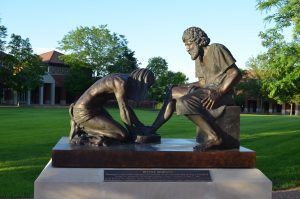 "This statue, entitled ""Divine Servant,"" was dedicated in 2003 in honor of Wisconsin Lutheran College's first president, Gary J. Greenfield."