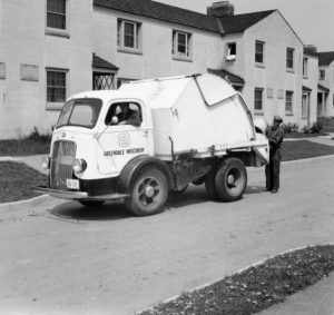 Two men working for the Greendale Department of Public Works collection trash in this photograph from the late 1930s or early 1940s.