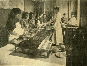 Cooking classes were a popular service offered by Milwaukee's settlement houses. This photograph of one such class was taken in 1907.