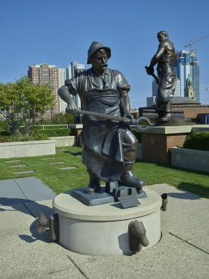 Bronze sculptures depicting various kinds of human labor are found on the roof of the Milwaukee School of Engineering's Grohmann Museum. Many of the statues depict foundry, blacksmithing, or mining work.