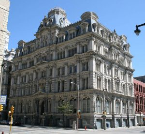 The ornate Mitchell Building was constructed in 1876 for wealthy businessman and politician Alexander Mitchell. It is listed on the National Register of Historic Places today.