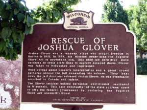 "In addition to a nearby mural, this sign in Cathedral Square marks the 1854 ""rescue"" of runaway slave Joshua Glover."