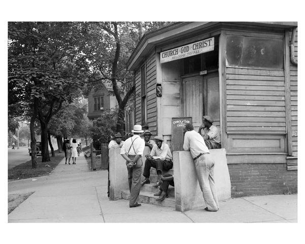 A group of parishioners gather on the steps of New Fellowship Church of God in Christ in 1939. The church was located on N. 8th Street.