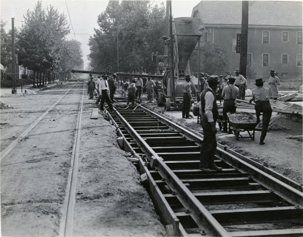 A group of men work to lay streetcar tracks along N. 8th Street in 1919.