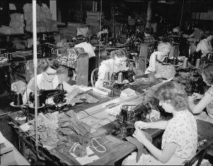 This group of women work to sew leather gloves at a Milwaukee factory in 1951.