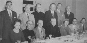 Catherine B. Cleary, seated third from the right, is pictured here in 1955 with her fellow members of Marquette University's 75th Anniversary Civic Committee. At the time, she was the vice-president of the  First Wisconsin Trust Co.