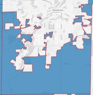 The Town of Waukesha's jagged boundaries include disconnected areas of land within the City of Waukesha, creating small islands. The Town of Waukesha is in blue, while the City of Waukesha is in white.
