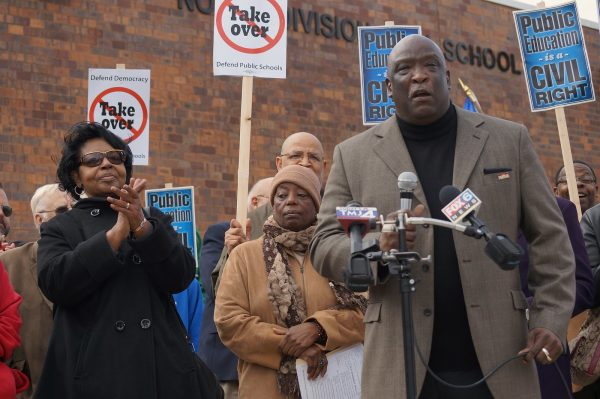 Rev. Willie Brisco addresses the media in 2013 to express opposition to legislation that would have required MPS to sell buildings to private companies. Rev. Brisco has served as president of both MICAH and WISDOM.