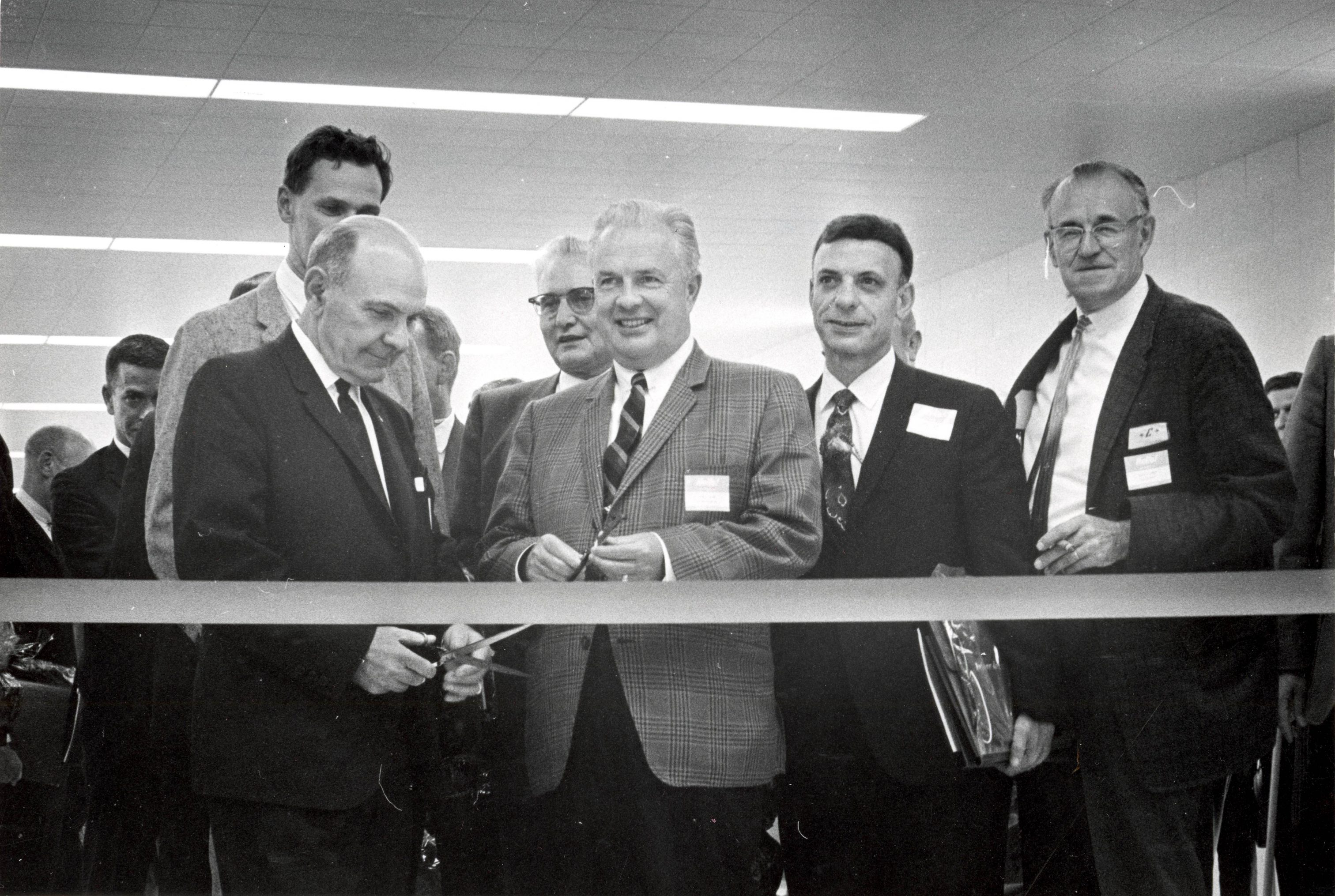 John Doyne (center) was Milwaukee's first county executive, elected in 1960. He is pictured here in 1967 at a ribbon-cutting ceremony at General Mitchell International Airport.