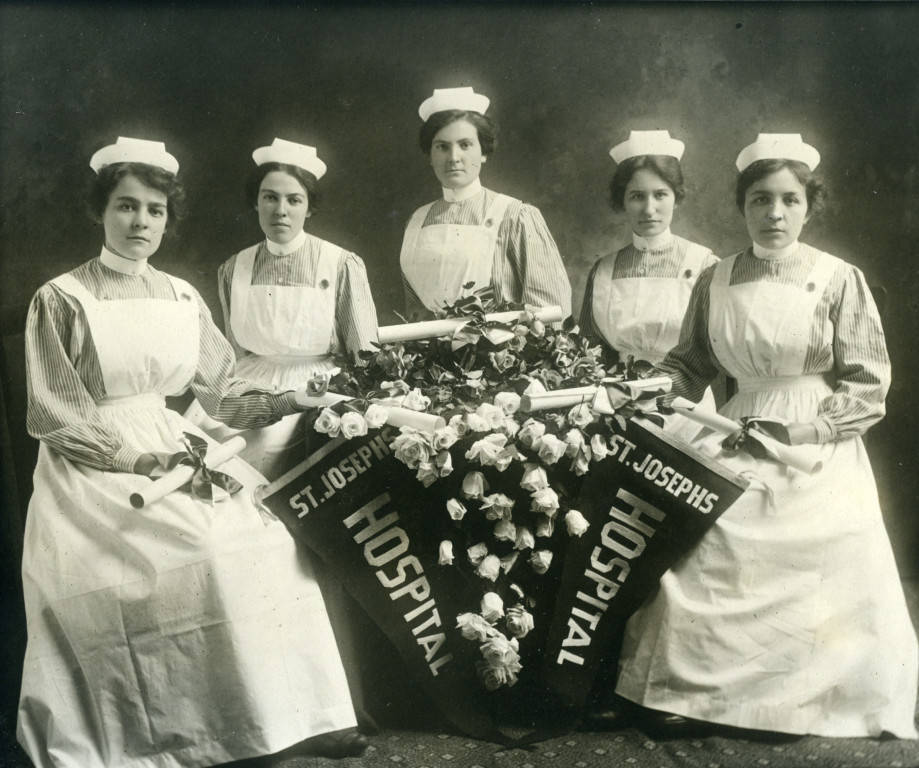 Five recent graduates of the St. Joseph's Hospital nursing program pose with their degrees in 1915.