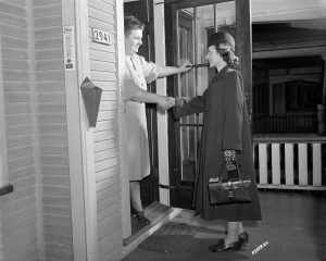 A visiting nurse arrives at the home of her Milwaukee patient in 1949.