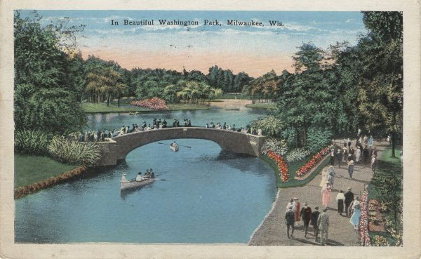 This 1929 post card illustrates groups of people enjoying the gardens and artificial lake of Washington Park.