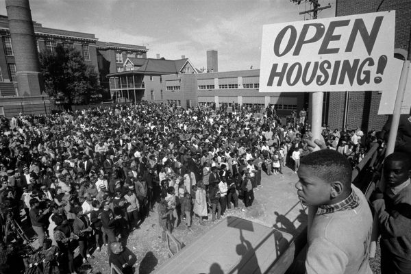 The Milwaukee Metropolitan Fair Housing Council was born out of the Civil Rights Movement and open housing demonstrations of the 1960s. A large group of such demonstrators are pictured here outside St. Boniface Church.
