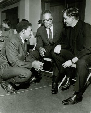 Lucius Walker (left) speaks to Reverend B.S. Gregg and Father Patrick Flood at a conference held at St. Matthew's Church in 1967. Walker was a leader of the OOO and all three men were active in the Civil Rights Movement.