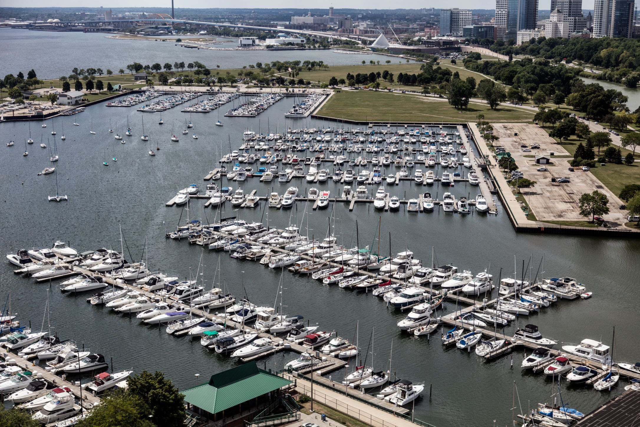 Boats fill McKinley Marina in the foreground while Milwaukee stretches along the coast of Lake Michigan in the background of this 2016 photograph.