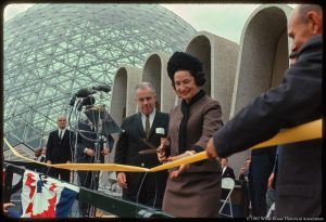 This photograph was taken on First Lady Lady Bird Johnson's beautification tour of Milwaukee, Wisconsin on September 21, 1965. In this photograph, Mrs. Johnson attends the dedication of the Mitchell Park Horticultural Conservatory. During her trip, she addressed the American Institute of Park Executives and toured the Boerner Botanical Gardens.