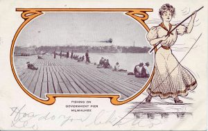 A long line of people fishing stretches down one of Milwaukee's government piers in this postcard from 1906.