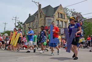Participants celebrate LGBTQ families at the Milwaukee Pride Parade in 2017.