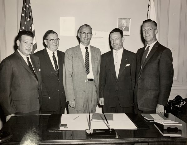 Jacob Friedrick (second from left) is pictured with his fellow members of the Berlin Trade Fair trade union team and Under Secretary of Labor James T. O'Connell (center) prior to their trip to Berlin in 1958.